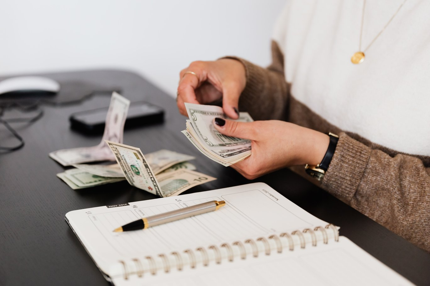 woman counting her money